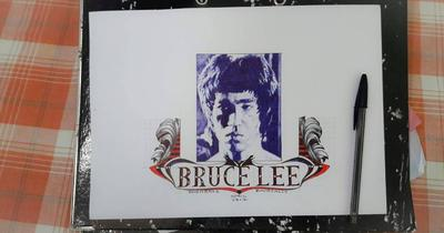 BRUCE LEE WITH BLUE BALLPOINT PEN
