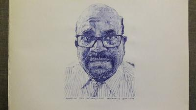 SERIOUS MAN WITH BLUE BALLPOINT PEN